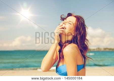 bright picture of laughing woman on the beach.