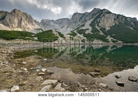 Dark Clouds over Sinanitsa Peak and lake, Pirin Mountain, Bulgaria