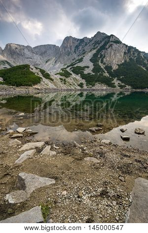 Landscape with Dark Clouds over Sinanitsa Peak and lake, Pirin Mountain, Bulgaria