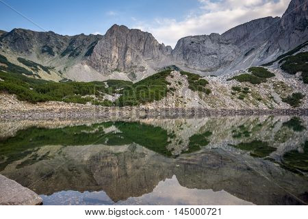 Amazing view of roks around  Sinanitsa Peak and reflection in the lake, Pirin Mountain, Bulgaria