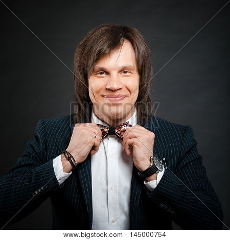 Happy Handsome Man With Long Hair Brunette And Brown Eyes In Dar