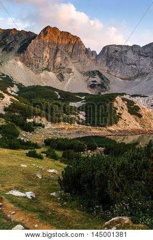 Sunset with Colored in red rock Around Sinanitsa peak and  the lake, Pirin Mountain, Bulgaria
