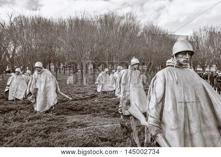 WASHINGTON, DC - DEC 19: Korean War Veterans Memorial in Washington, DC, as seen on December 19, 2015. The memorial consists of 19 stainless steel statues. This is a sepia version of the shot.