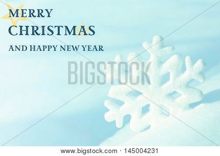 Christmas card. Beautiful snowflake on natural snowdrift, close up