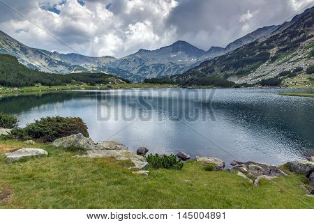 Panoramic view of Banderishki chukar peak and Reflection in Muratovo lake, Pirin Mountain, Bulgaria