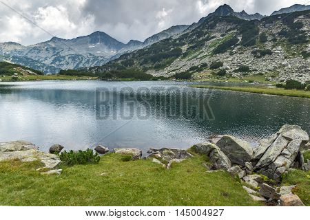 Amazing panorama of Banderishki chukar peak and Reflection in Muratovo lake, Pirin Mountain, Bulgaria