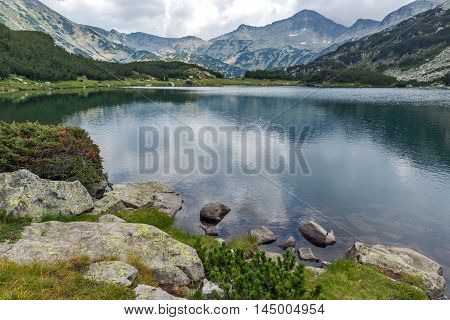 Clouds over Banderishki chukar peak and Reflection in Muratovo lake, Pirin Mountain, Bulgaria