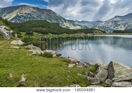 Panoramic view of todorka peak and Reflection in Muratovo lake, Pirin Mountain, Bulgaria