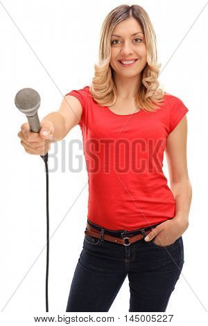 Young woman holding a microphone and doing an interview isolated on white background