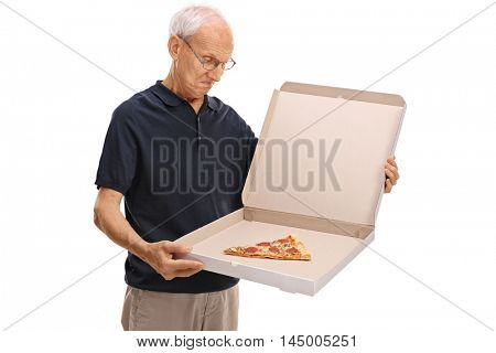 Disappointed senior looking at a pizza box with a single slice of pizza isolated on white background