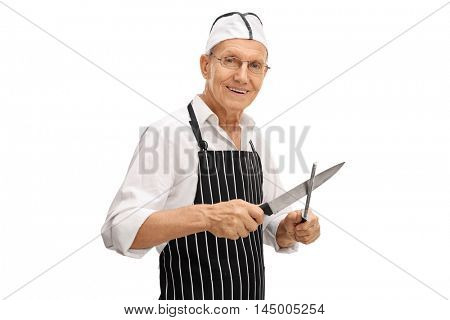 Elderly butcher sharpening his knife isolated on white background