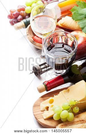Red and white wine, grape, cheese, bread and sausages. Isolated on white background with copy space