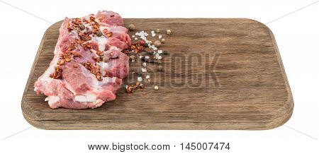 raw pork ribs with chili peppers on cutting board isolated on white.