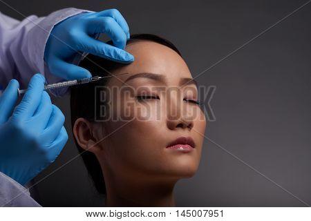Asian pretty young woman having beauty treatment
