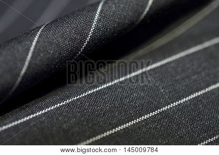 close up dark blue fabric of suit photo shoot by depth of field for object