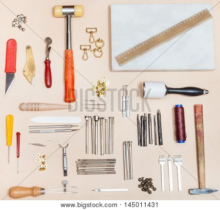 Various Leatherwork Tools And Marble Board