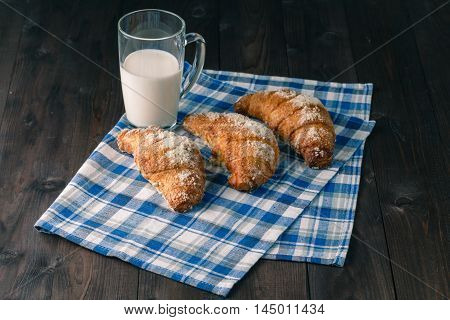 Breakfast with coffee crema milk fresh croissants on vintage on wooden background