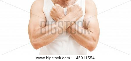 Man In White Shirt Holds Fists Near Chest, Isolated