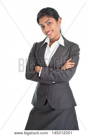 Portrait of black business woman in formalwear arms crossed and smiling, isolated on white background.