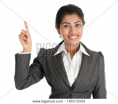 Portrait of black business woman in formalwear finger pointing at blank space, isolated on white background.