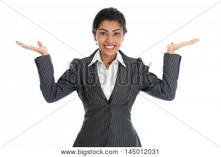 Black business woman in formalwear smiling and hands displaying something, isolated on white background.