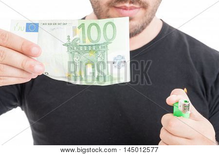 Young Male Burning Money With Lighter