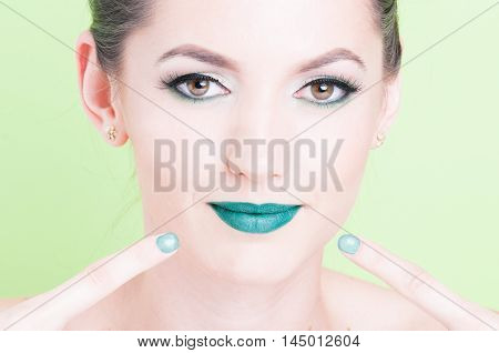 Woman Pointing Her Lips Wearing Professional Glamorous Make-up