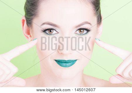 Woman Pointing Her Eyes Wearing Professional Glamorous Make-up