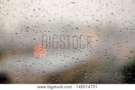 drops glass lights rain stormwater window cars macro