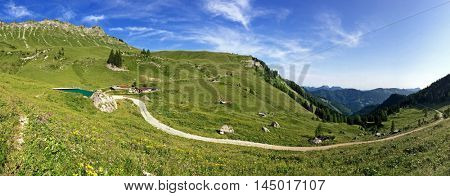 Panoramic view of Kafell peak, other peaks during summer in Tyrol, Austria. Panorama of view from Hochplatte mountain peak at 1,813 m. Kafell ranks as 1106th highest mountain in Achenkirch, Austria