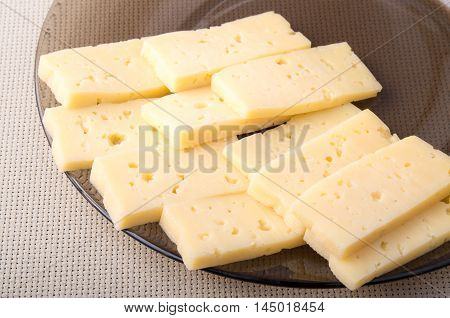 Pieces Of Dry Yellow Hard Cheese On A Plate Closeup