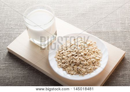Saucer Of Cereal And A Glass Of Milk