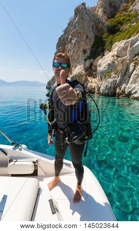 Male Scuba Diver shows the thumbs up sign