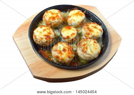 baked mushrooms with cheese in a pan