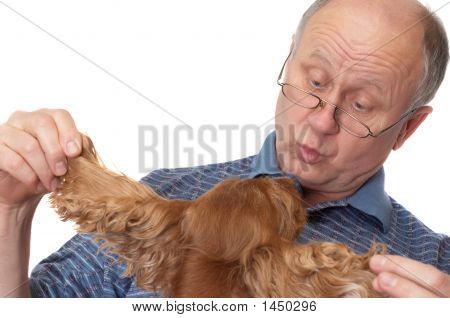 Bald Senior Man With Dog