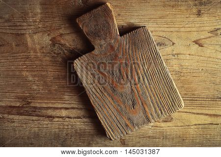 Empty cutting board on wooden planks background