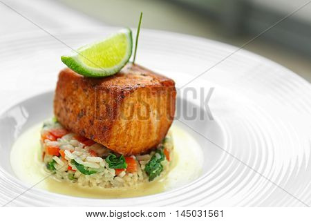 Delicious meat with rice and lime on white plate