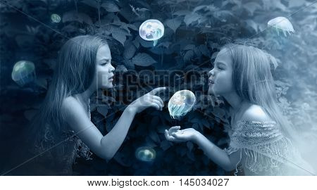 Photo manipulation in blue with girls and jellyfish