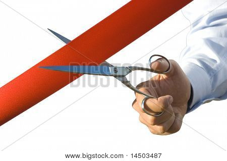 Red ribbon cutting with a pair of scissors for the inauguration of the new business activity in white background