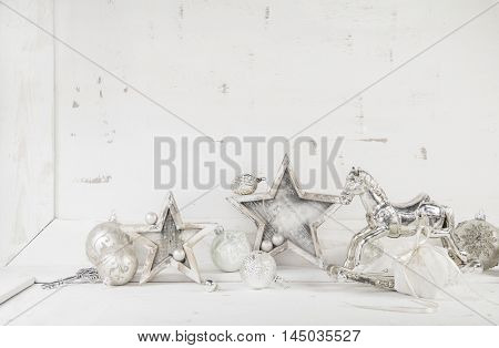 Shabby chic white beige christmas decoration on a wooden wall or background.