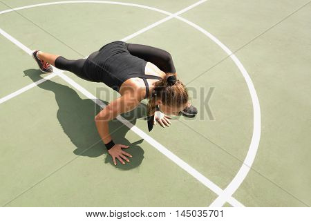 Young woman exercising on the floor, toned image