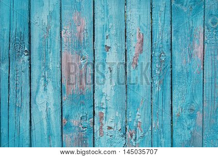 blue shabby wooden planks, wooden palisade background with paint scratches