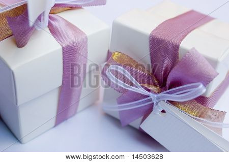White wedding keepsake close-up with violet ribbon to celebrate a very special day