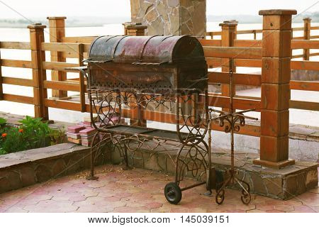 Large forged barbecue grill outdoor