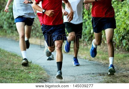 Boys running fast training for cross country