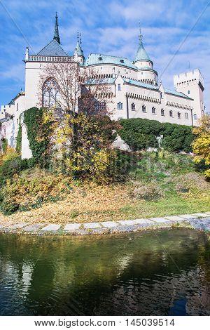 Bojnice castle with water reservoir in Slovak republic. Cultural heritage. Seasonal scene. Autumn trees. Beautiful place. Vibrant colors.