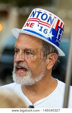 Lancaster PA - August 30 2016: A man wearing a Hillary Clinton hat a rally for Virginia Senator Tim Kaine.