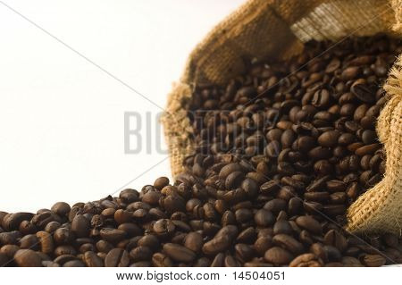 Burlap bag of coffee beans detail. Selective depth of focus