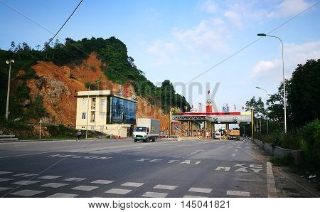 Hoa Binh, Vietnam - Aug 31, 2016: Vehicles travelling through a fee booth on No.6 road from Hanoi to the north west provinces.