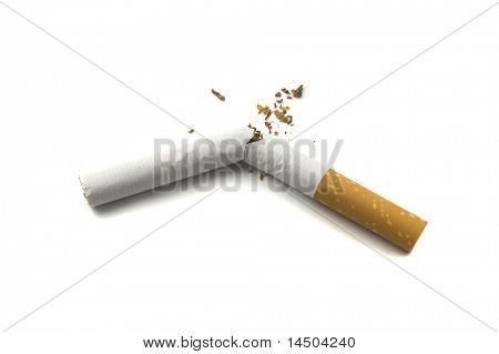 Broken cigarette isolated on white background. Stop smoking concept.